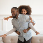 man with daughter with no back pain